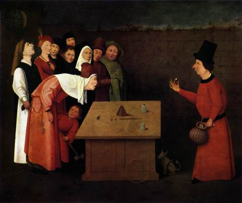 """The Conjurer,"" painted by Hieronymus Bosch (between 1496 - 1520). The painting accurately displays a performer doing the cups and balls routine, which has been practiced since Egyptian times. The shell game does have some origins in this old trick. The real trick of this painting is the pickpocket who is working for the conjurer. The pickpocket is robbing the spectator who is bent over. (Source: Wikipedia)"